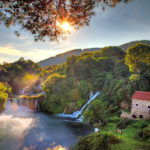 Beautiful long exposure panorama over a couple of waterfalls of